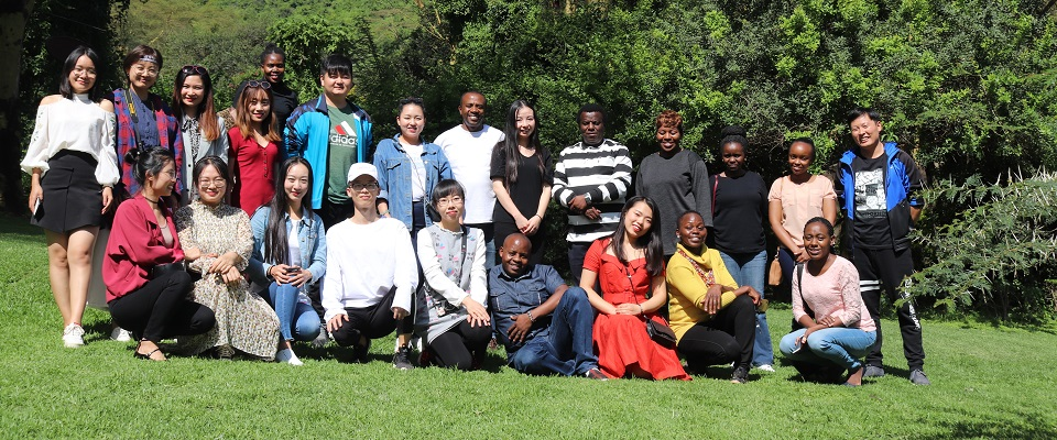Figure1-The CI Chinese and local staff pose for a photo at the lion hill camp in Nakuru,June2018.