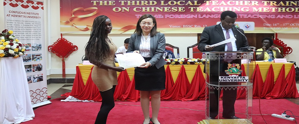 Figure1-The Chinese Director,Prof.Li Jing awarding a certificate to one of the participants at the close of the Teacher Training Seminar at the BSSC-October,2018